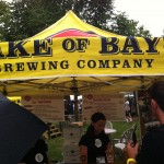 Servers pour beer under the Lake of Bays Brewing Company tent at Toronto's Festival of Beer.