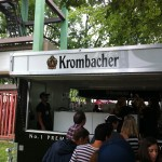 People line up to taste Krombacher beer served from a modified food trailer at Toronto's Festival of Beer.