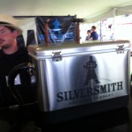 A gentleman in a straw hat waits to serve Silversmith Black Lager to people at Toronto's Festival of Beer