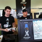 Two gentlemen in black Snowman Brewing Co. t-shirts wait to pour Pail Ale at Toronto's Festival of Beer