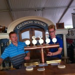 Two young men staff the Creemore Springs bar at Toronto's Festival of Beer