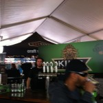 A young man waits to pour some samples of King Brewery beer at Toronto's Festival of Beer