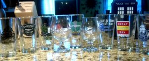 A line of Long Island brewery imprinted pint glasses